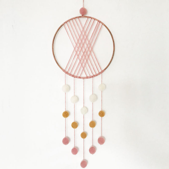 pink macrame pom pom wall decor