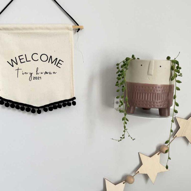 Welcome tiny human wall hanging